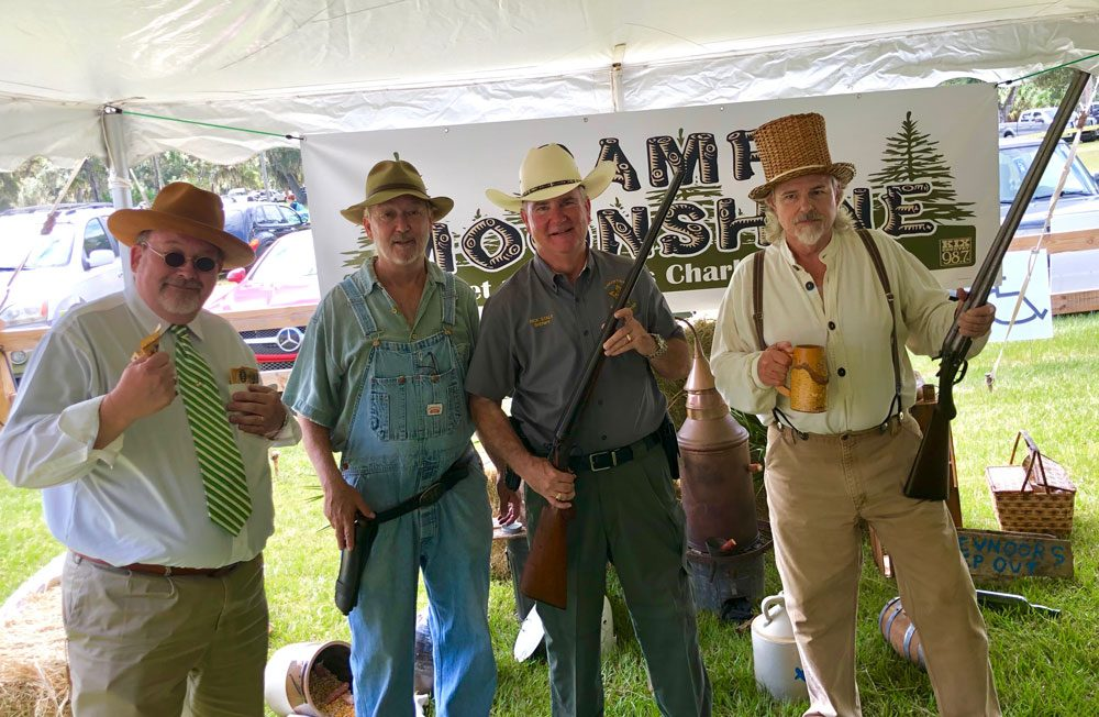 Sheriff Rick Staly arrested some moonshiners at the Creekside Festival over the weekend, the Flagler Chamber's annual two-day event that, this year, drew very large crowds.