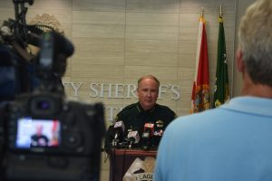 Sheriff Staly at today's press conference, held shortly after his return from attending the funeral of Matthew Baxter, a 26-year-old Kissimmee police officer and father of four murdered Friday night. Click on the image for larger view. (© FlaglerLive)