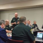 Sheriff Rick Staly meeting with his top staff and other law enforcement officials last May. Coronavirus has created a slew of new and uncharted challenges as the sheriff now has two of his deputies on self-quarantine. (© FlaglerLive)