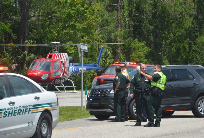 Sheriff Rick Staly and deputies at a crash scene on U.S. 1 on May 24. (© FlaglerLive)