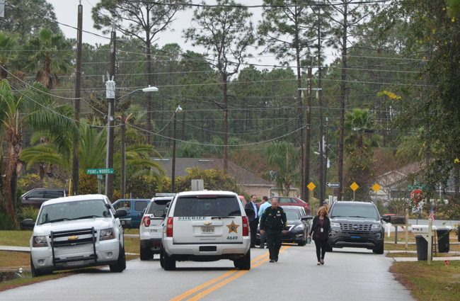 Sheriff Rick Staly and Brittany Kershaw, the sheriff's public information officer, were at the scene of a death the sheriff was considering suspicious this morning on Point Pleasant Drive in Palm Coast. (© FlaglerLive)