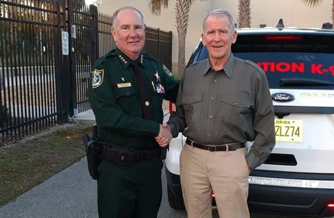 Flagler County Sheriff Rick Staly, an NRA Officer of the Year nominee, patrolled and dined with Oliver North on Monday. (FCSO)