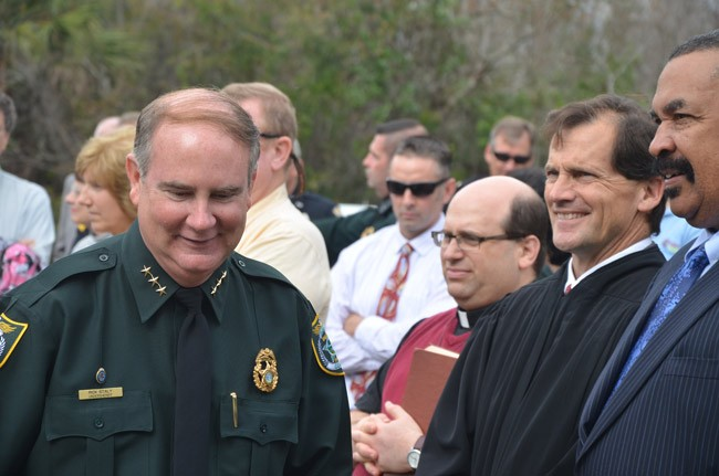 Undersheriff Rick Staly, left,  at Sheriff Jim Manfre's inauguration in January 2013, with Judge Dennis Craig and Sid Nowell, the sheriff's attorney. (© FlaglerLive)