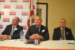 From left, Rick Staly, Mark Whisenant and Chris Yates. Click on the image for larger view. (© FlaglerLive)