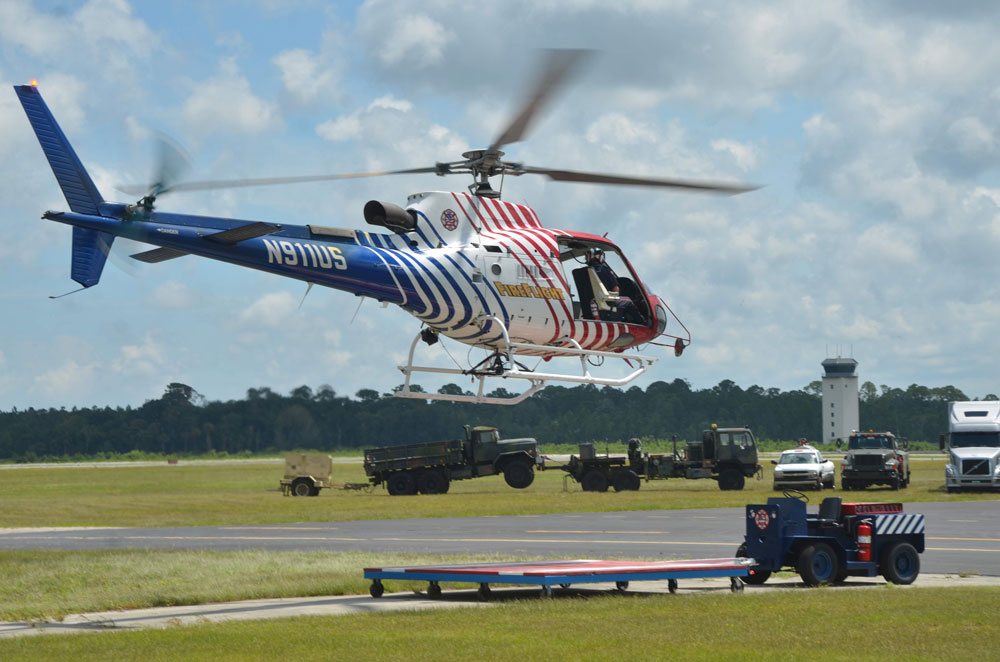 Flagler County Fire Flight, the emergency helicopter, wa splaced on standby Sunday in anticipation of responding to the supposed shooting of a woman in the head. The call turned out to be a prank. (© FlaglerLive)