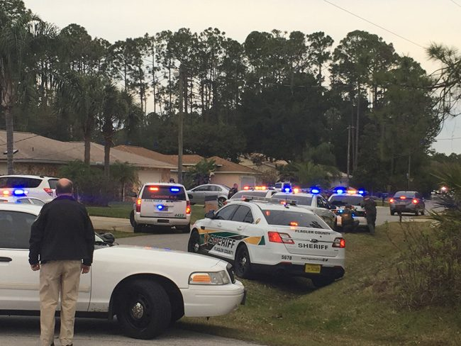 Some 20 Flagler County Sheriff's units  have surrounded a suspect in a stolen vehicle in Palm Coast's B Section in a standoff that began in late afternoon. The suspect is in the vehicle to the right. The vehicle has been idling throughout. Sheriff Rick Staly, to the left, is at the scene with much of his command staff. (FCSO)