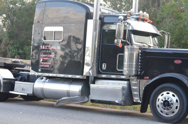 The motorcycle appears to have been clipped by the metal step on the passenger side of the truck's cab. See the more detailed picture below. Click on the image for larger view. (c FlaglerLive)