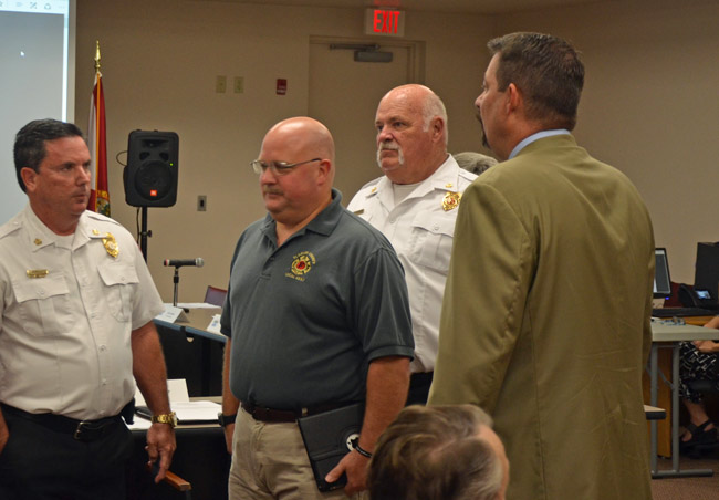 Stephen Palmer, second from left, authored the letter to County Commission Chairman Don O'Brien regarding the firefighters' union's no-confidence vote in County Administrator Craig Coffey, right. Palmer and Coffey are seen here at a 2017 meeting, with Fire Chief Don Petito, left, and now-retired Bunnel Fire Chief Ron Bolser. (© FlaglerLive)
