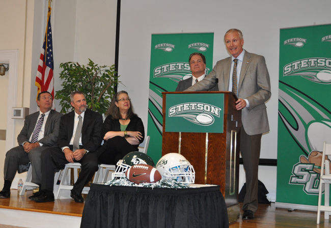 """Roger Hughes at the press conference where he was announced as Stetson's new head football coach. From left, DeLand Mayor Bob Apgar, Stetson Board of Trustees Chair Harlan """"Butch"""" Paul, Stetson President Wendy Libby and Athletic Director Jeff Altier."""