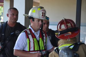 Flagler Beach Fire Department Captain Steve Cox at this morning's fire at Flagler Plaza. (© FlaglerLive)