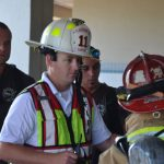 Flagler Beach Fire Department Capt. Steve Cox, center. (© FlaglerLive)