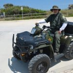 Steve Williams, a veteran Flagler County Sheriff's deputy, on his ATV during a beach-patrol assignment. (© FlaglerLive)