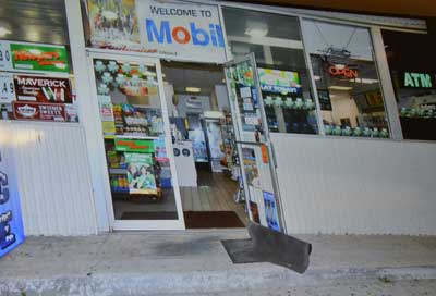 A still shown at trial, showing the Mobil convenience store the night of the shooting. (© FlaglerLive)
