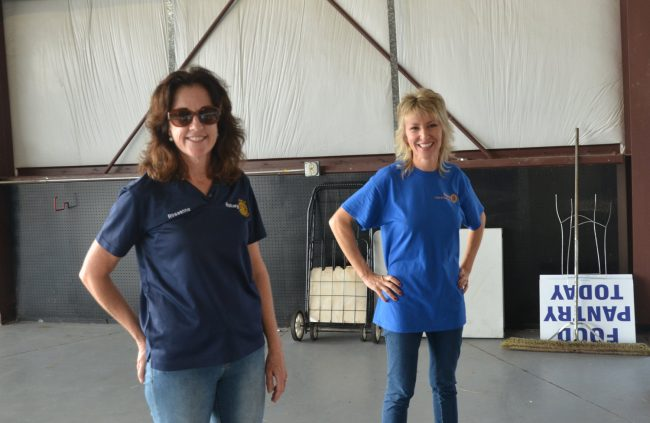 "The Flagler Beach Rotary's Roseanne Stocker, in the foreground, and Cindy Dalecki, driving forces in an organization of barely more than 40 members that seems to be doing the job of thousands. Stocker started Project Warm 18 years ago, when, as she put it, 'it was my dad and me in our cars."" Click on the image for larger view. (© FlaglerLive)"
