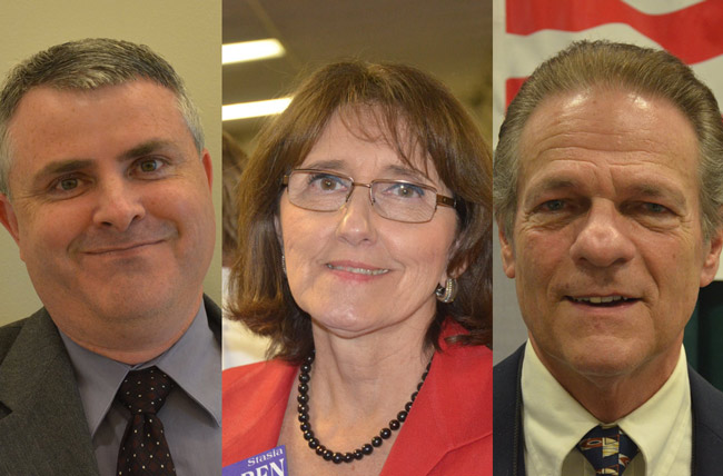 Some of the Tea Party straw poll's big winners: Scott Westbrook, left, one of seven candidates for county judge, Stasia Warren, who's challenging R.J. Larizza for State Attorney, and Ray Stevens, one of three Republicans running for Sheriff in the Aug. 14 primary. (© FlaglerLive)