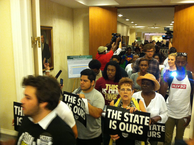 The Dream Defenders marching into Gov. Rick Scott's office Tuesday, asking for a special session to address Florida's permissive gun laws. (© Tom Urban/News Service of Florida)
