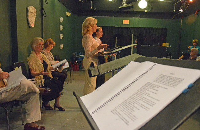 Annie Gaybis, standing in the foreground, and Ann Kraft sitting behind her, during a preview of 'Suddenly Last Summer.' (© FlaglerLive)