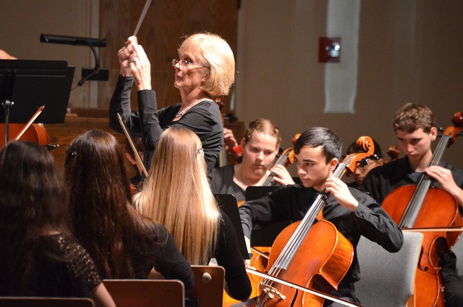 Sue Cryan conducting the FYO's  Harmony Chamber  Ensemble earlier this year at the Methodist church. (© FlaglerLive)