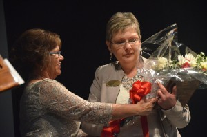 Sue McVeigh accepting the honors from Superintendent Janet Valentine. Click on the image for larger view. (© FlaglerLive)