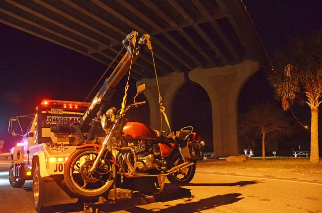 The man had ridden an unmarked motorcycle, a Suziki, to the middle of the bridge before jumping off. Click on the image for larger view. (© FlaglerLive)