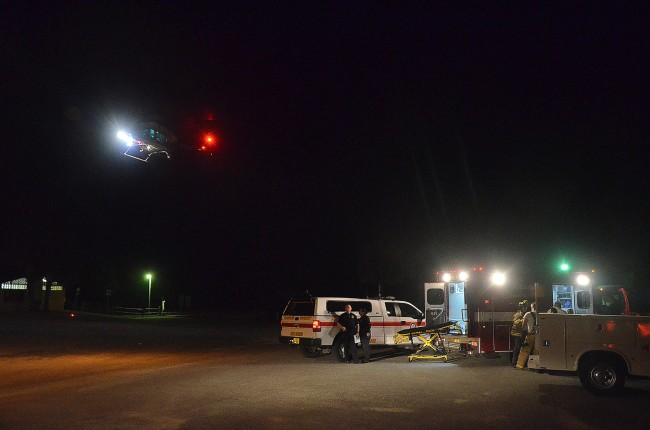 Volusia County's Air One rescue helicopter lifts off at 9:56 p.m. from the parking lot of the Moody Boat Launch at the foot of the Flagler Beach bridge, with a man called 'Jim' on board. Click on the image for larger view. (© FlaglerLive).