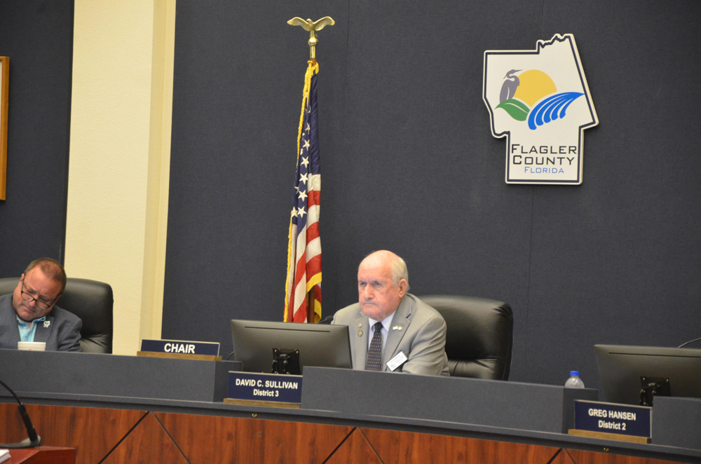 Speaking for most of the Flagler County Commission, Commission Chairman Dave Sullivan today did not address a request by residents for a statement of public support for all citizens, regardless of party, following more criticism of Joe Mullins's statements online. Mullins is to the left. (© FlaglerLive)