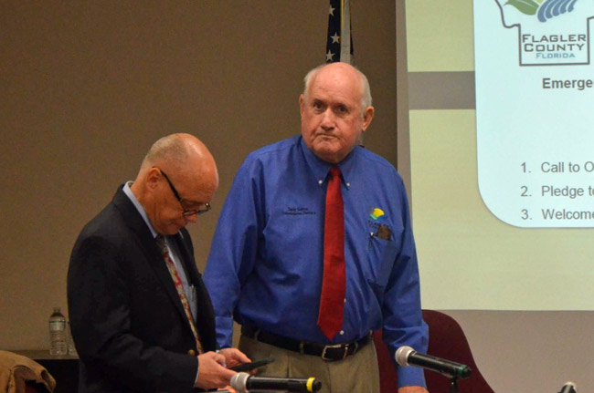 County Commissioner Dave Sullivan, right, changed his mind and threw his support behind a $240,000 plan to build storage space for the sheriff. He was joined by Commission Chairman Don O'Brien and two other commissioners. (© FlaglerLive)