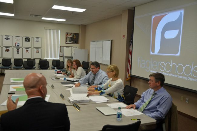 The Flagler County School Board's dynamics have changed markedly since Trevor Tucker, right, became its chairman, coinciding with the board's search for a replacement for Superintendent Jacob Oliva, in the foreground. Oliva is taking a job at the state Department of Education. (c FlaglerLive)