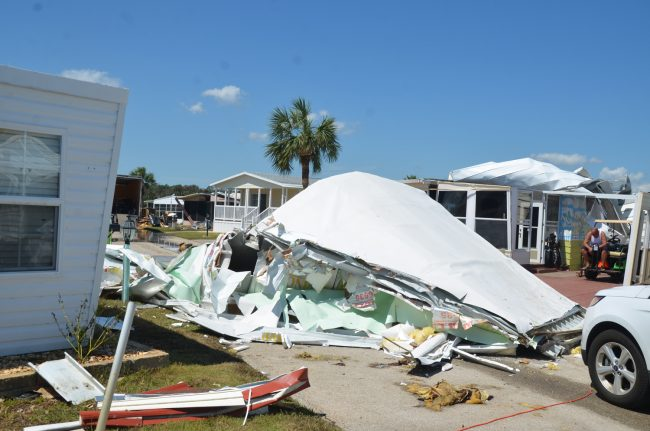 At Surfside Estates, the mobile home community in beverly Beach, whole roofs were ripped off and slammed into the street, but the more extensive damage, which struck most homes, was the flooding. Tim Arnold, above, is sitting by the damaged house his fiancee Lorri Benson owns. Click on the image for larger view.b (c FlaglerLive)