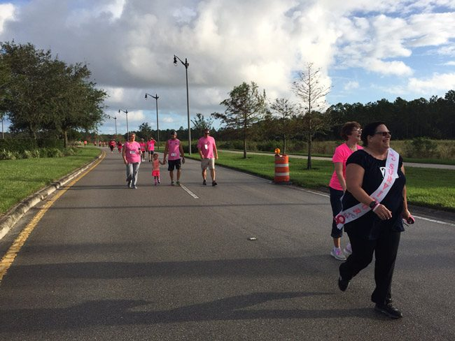 A survivor among the thousand-off walkers and runners in Sunday's Pink Army Run from Florida Hospital Flagler, through Town Center and back. (© FlaglerLive)