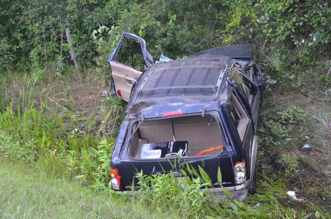 The SUV after it was righted, but still in the ditch. Click on the image for larger view. (© FlaglerLive)