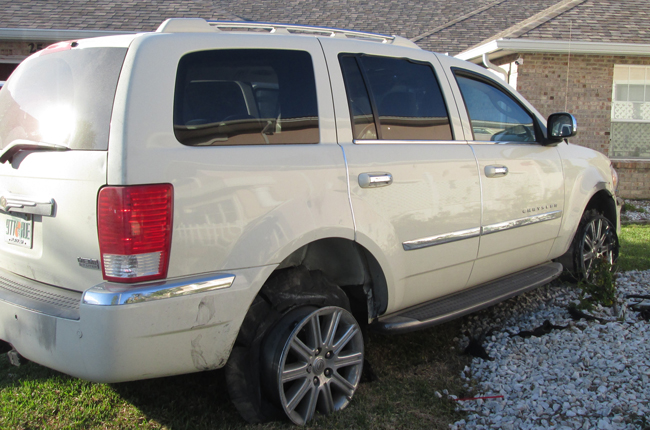 The SUV Richard Knoblaugh drove and crashed in his own C-Section yard Monday evening. (FCSO)
