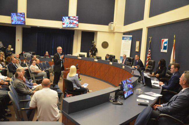 Superintendent Jim Tager addressing members of the state Board of Education Friday in Bunnell. (© FlaglerLive)