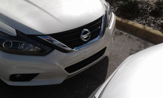 The superintendent's Nissan appears to have sustained the most damage out of the three vehicles, a minor indentation in the center of the bumper. (Flagler Schools)