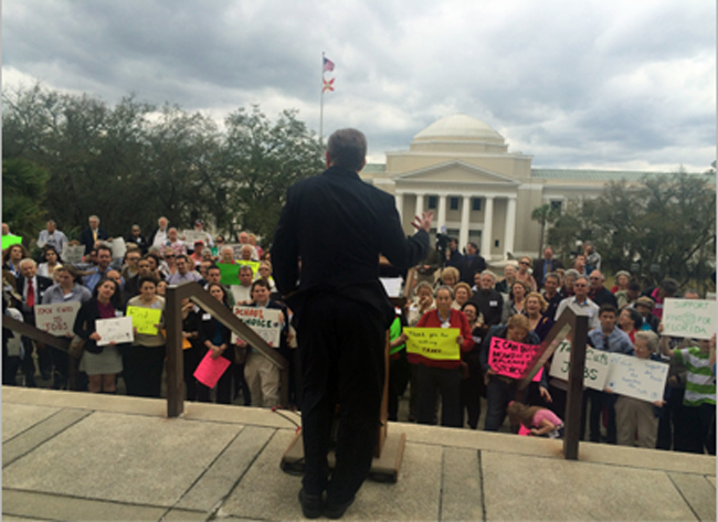 Americans for Prosperity Director Slade O'Brien addressing a rally outside the Capitol today. (© News Service of Florida)