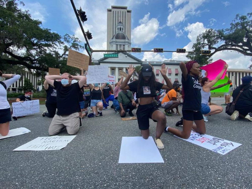 Protesters in Tallahassee, where the driver of a pickup truck plowed through a street packed with demonstrators, just blocks from the state Capitol building. (NSF)