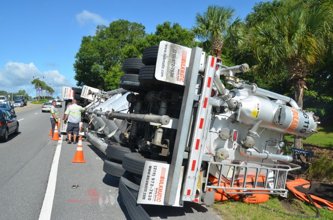 Crews were to lift the overturned tanker truck with air bags before righting it with cables. Click on the image for larger view. (© FlaglerLive)