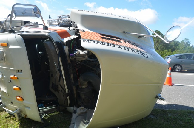 The truck, belonging to Tampa-based Bulkmatic Transport, sustained severe damage. Click on the image for larger view. (© FlaglerLive)