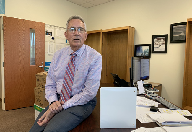 Tom Tant, the Flagler school district's finance chief, is eager to explain why the state's allegations of an education funding increase for Flagler aren't nearly what they seem. His office's shelves were bare because he was temporarily moving to a different floor for renovations. (c FlaglerLive)