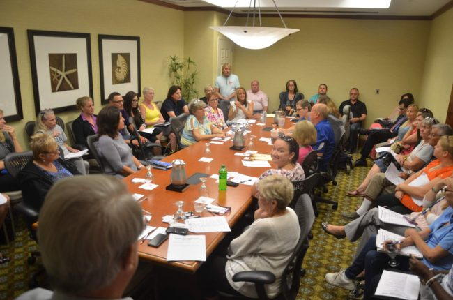 Monday's opioid 'task force' meeting drew some 45 people crowded into a room with a posted capacity of 20. (© FlaglerLive)