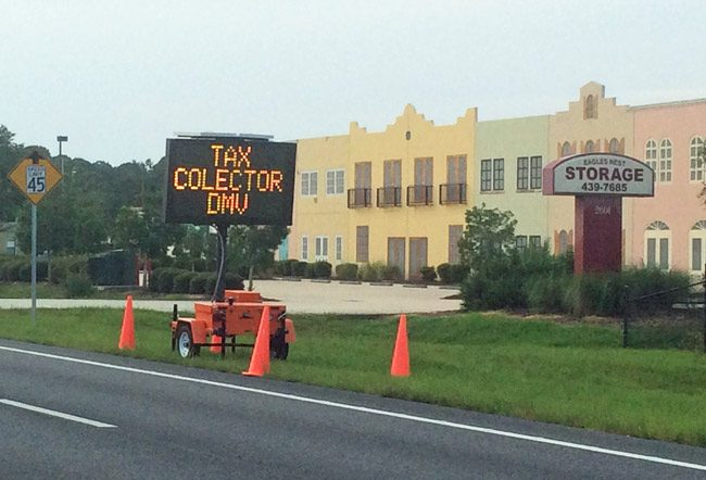 Flagler County Emergency Services installed a temporary electronic sign on behalf of the tax collector to direct traffic to the collector's relatively new branch in Flagler Beach. That city's commissioners did not like it. (© FlaglerLive)