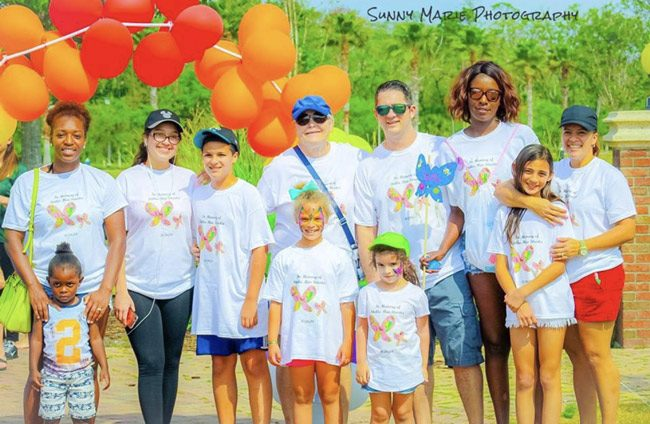 Participants in the Tears Foundation's First Annual Palm Coast Rock Walk last Saturday at Town Center.
