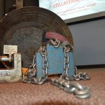 Chains and weights used to tether and 'train' dogs, on display at Flagler County's Emergency Operations Center last November during an ASPCA seminar on animal cruelty. A revised animal ordinance in Flagler bans all such chains, weights or other injurious equipment used on dogs. (© FlaglerLive)