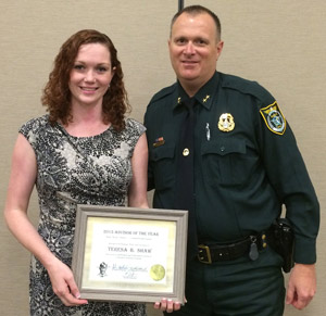 Sheriff's Office Victim Advocate Teresa Shaw with Cmdr. Steve Cole.