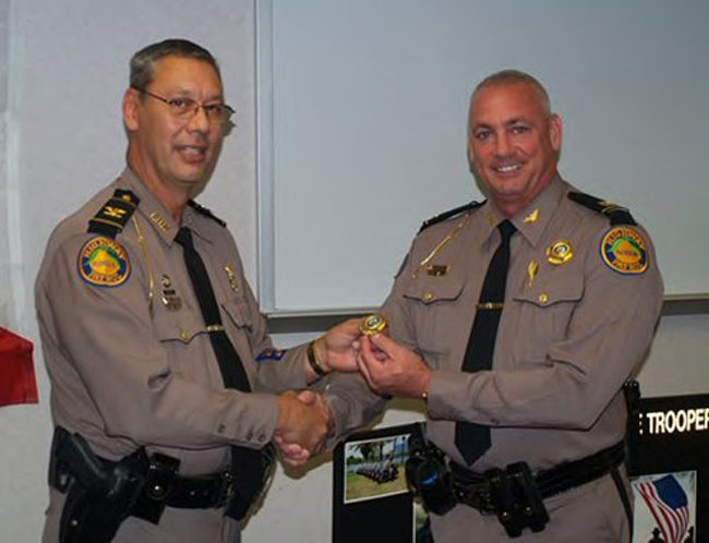 The Florida Highway Patrol's Michael Thomas, right, when FHP Director David Brierton promoted him in 2011. (FHP)