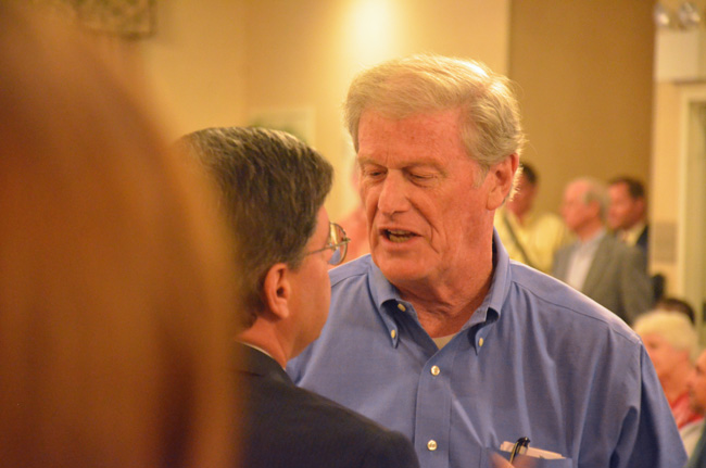 I'll be seeing ya: John Thrasher talking to County Commissioner Nate McLaughlin in early August. (© FlaglerLive)