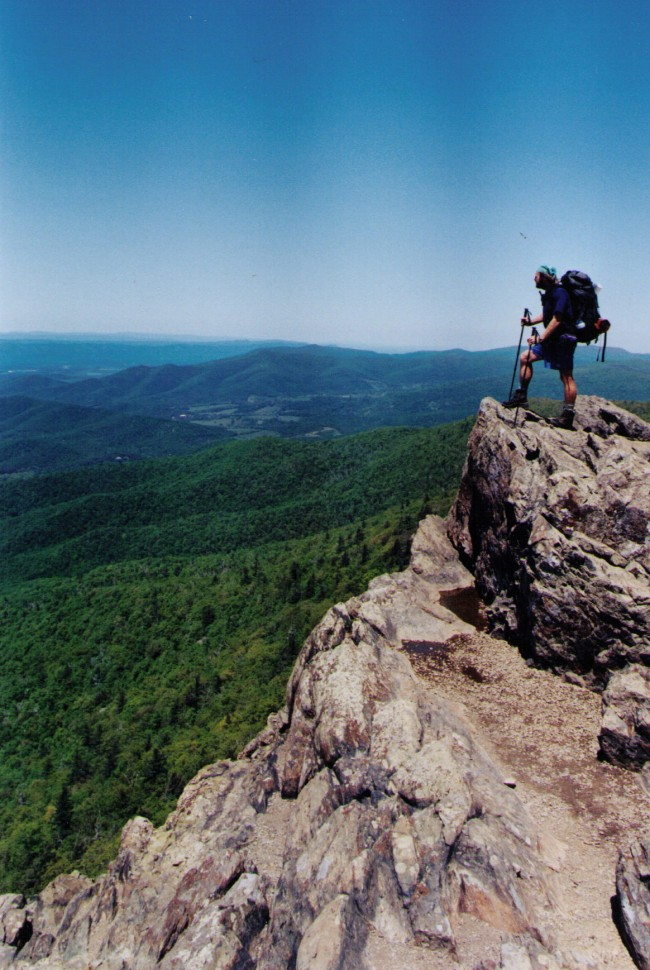 A thru-hiker who went only by his trail name, Sheltowee (a Shawnee name) stands atop Stony Man Mountain, along the Appalachian Trail, at 4010 feet the second-highest peak in the Shenandoah. (© Pierre Tristam)