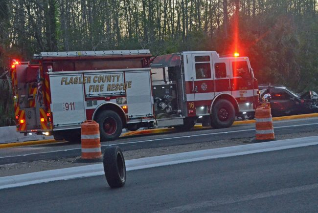 A lone tire stood upright a few feet from the crash scene. Click on the image for larger view. (© FlaglerLive)