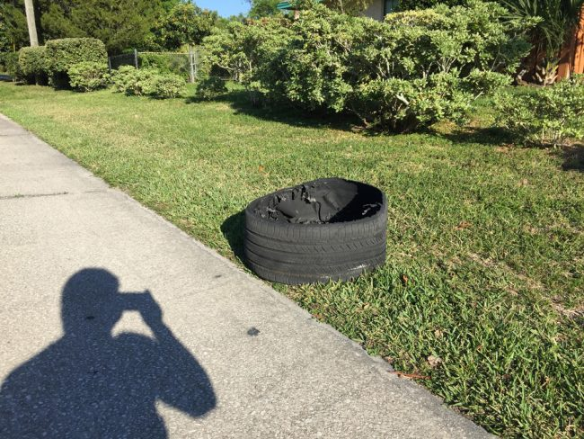 One of the SUV's tire shards off a C-Section street. (c D. Evanac for FlaglerLive)