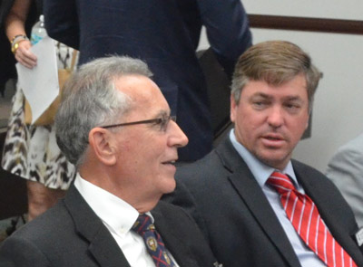 Flagler School District Finance Director Tom Tant, left, with School Board Chairman Trevor Tucker during last month's legislative delegation meeting, where Tucker asked legislative representatives to address the unfairness of a school funding formula that penalizes Flagler. (© FlaglerLive)